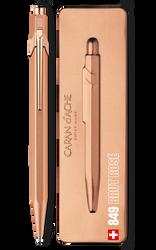 Rose gold pen beside pen case.