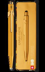 Gold pen beside pen case