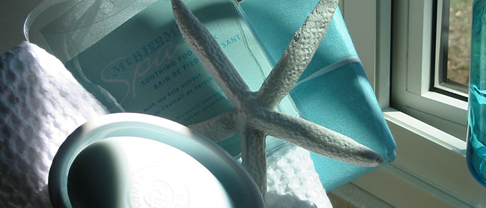 Blue-green painted starfish, towel and soap in dish
