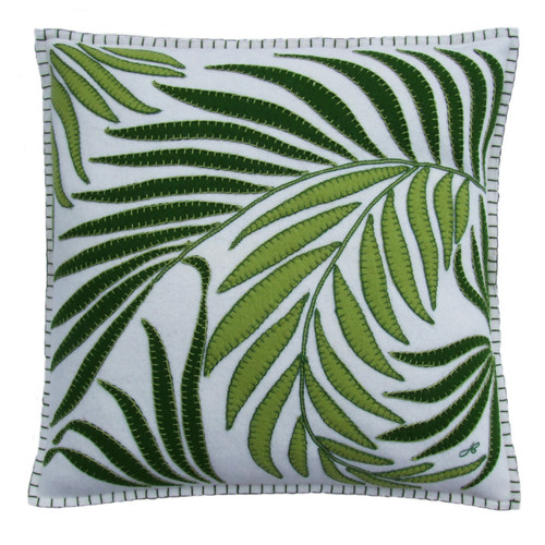 Cream square palm cushion, dark and light green leaves on cream wool.