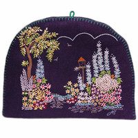 Purple felt garden tea cosy