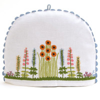 Flowers and trees white linen tea cosy
