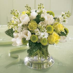 A Lovely expression of comfort, this soothing bouquet of white Tulips and Stock with Jade roses and green button pompons is ideal to send to the family's home. Arranged in a pretty  glass vase, it can easily be displayed in any room.