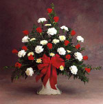 This bouquet expresses deep feelings beautifully with red and white flowers, lush greenery and a large bow. Appropriate for a funeral.
