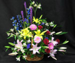 A large multi-coloured tribute of mixed seasonal flowers. A grand expression of your sympathy.