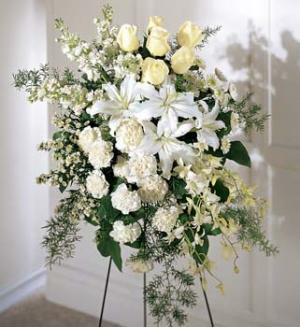 This soft standing spray is a sophisticated way to pay a quiet tribute. White fragrant Oriental lilies, roses, stock or snapdragons.
