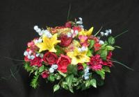 Beautifully arranged red silk flowers with yellow lillies. These flowers will attach to the gravestone. Sometimes called a tomb topper.These are artificial flowers.