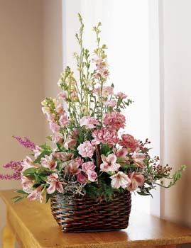 An array of pink blooms artfully arranged is a celebration of life and a special memory of a dear friend or loved one.