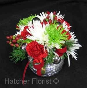 Silver bells... it's Christmastime in the city! Shine on with this silver, red, white, and green arrangement. It's not too big, just the perfect size and perfect way to say Merry Christmas!