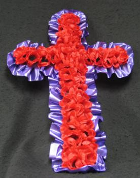 A sophisticated purple cross with silk red poppies. This memorial is perfect for a loved one who lost their life during the war.