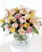 Comfort with the affection of refined mixed pastel roses and sophisticated greenery in a pedestal vase.