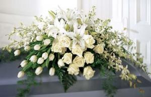 Resplendent with roses, Tulips, orchids, and lilies, this spray is an elegant and sophisticated display.