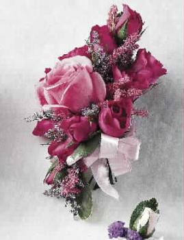 Corsage of deep pink roses and magenta alstroemeria.