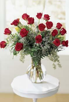 Express your innermost feelings with this romantic bouquet. 18 roses, limonium and seeded eucalyptus are beautifully arranged in a glass vase. Sure to impress. Available in pink, red, yellow, white or peach.