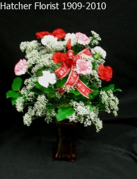 Cupid's Valentine carnation vase. 12 red, white and pink carnations and baby breath arranged in a vase. Topped off with a pretty Valentine bow. pleaseing Valentine's since 1909. Eco flowers delivered in Toronto, North York and area.
