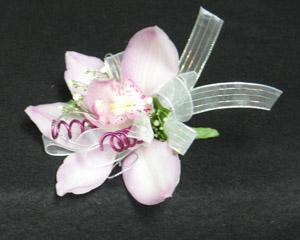 A pin on type, with pink mauve wire. We also make wristlets. A double Cymbidium corsage.