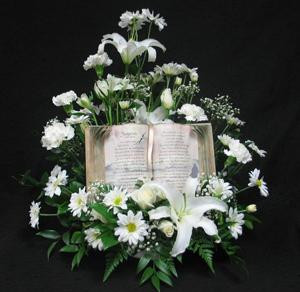 "Send condolences to the home or office with a white tribute arrangement, which contains a keepsake book with the ""Footprints"" poem. A unique design we can have delivered for you in the Toronto area."