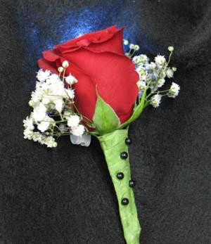 Single red Rose boutonniere and Baby Breath. And a funky white LED light. Shine on! The light lasts 24 hours, a great effect!