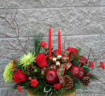 The Christams elves can deliver this arrangement for you. Two tapers, red apples, BC holly, pine cones, green revert mums, red carnations, red roses, pine, douglas fir, red Dogwood, tartan bow. Call Hatcher Florist or web us your order we deliver all over Toronto and the Golden Horseshoe.