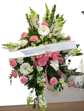 Mixed pink and white spray of gerbera, snapdragons, pink carnations and baby pink alstroemeria. Script is available as well. We deliver to all Toronto and area funeral homes, churches and visitation chapels.