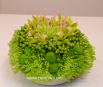 Green flower birthday cake we made for an Irish birthday party. We can use anynatural flower colour. Pink, yellow, mauve or a mixture. Notice the little candles.