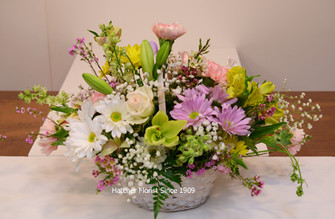 Spring basket made with a mixture of our freshest, seasonal blooms.