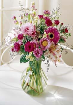 Lovely mix of pink and fuschia flowers, roses, gerbera,aster, limonium and alstroemeria.