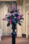 Large artificial arrangement we made at our flower shop for a school's commencement.