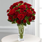 The FTD® Sweethearts® Bouquet blooms with roses and mini carnations to help you celebrate this coming Valentine's day! Brilliant red roses are brought together with burgundy mini carnations and lush greens to form an exquisite flower bouquet your sweetie won't soon forget. Presented in a designer clear glass vase, this flower arrangement will sweep them off their feet with each stunning red blossom to express your heart's every desire this February 14th.