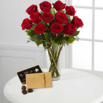 The FTD® Red Rose and Godiva Bouquet is simply the sweetest way to send your love and affection. A bouquet of red roses accented with seeded eucalyptus and lush greens arrives arranged in a clear glass vase and accompanied by an 8-piece gold box of Godiva Chocolates. This pairing of beauty and indulgence creates a wonderful and memorable gift that won't go unnoticed.