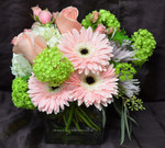"This Spring floral design will grace and beautify any family table, office or reception area.  We can send this lovely cube for a Seder Passover table, an Easter centrepiece or for any celebration. Delivery from our Toronto-North York century old flower shop. When you think Toronto florist, "" Think Hatcher Flowers ."" Spring Cube Pastel 2013."