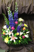 Large basket of flowers for you send with your most heartfelt sentiments.