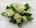White spray roses are really petite and lovely. We a can use other colours as well, please call in advance or order 5 to 7 days ahead. In store we have extra special wristlets by Fitz Design.  We custom make each corsage in our Toronto/North York shop. We really appreciate the advance orders. Do not forget the boutonnieres.