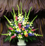 Gladiolus, snapdragons, lilies, roses and lisianthus in our traditional styled Summer Tribute. We deliver to all funeral homes in the Toronto and GTA area. We also sell banners for the funeral work.