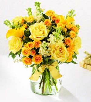 Their Golden Anniversary is a milestone worthy of celebration. Congratulate them for their accomplishment with this special gift. Our golden bouquet holds yellow roses, yellow snapdragons and creamy, fragrant Stock or Snapdragons. All are arranged in a  glass vase and trimmed with a gold ribbon bow. We can arrange the flower delivery anytime.