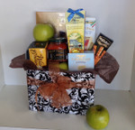 Send one of our lovely gourmet samplers. We use a fresh selection of unique items from around the world. The apples are just for decoration!