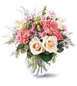 This sweet arrangement contains white roses, cream Versilia Roses, pink Snapdragons, pink Carnations, mixed foliage and Limonium. Flowers by Sierra Eco Toronto.