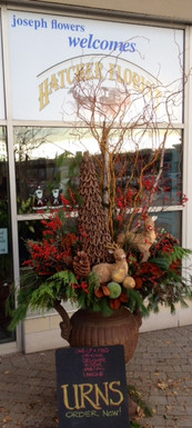 Here is an example of our custom made Winter urn. This one is on the upper end of our price point. Call today for a price. We create them at your location, Toronto, North York,  Thornhill and Richmond Hill.