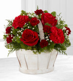 FTD® proudly presents the Better Homes and Gardens® Celebrate the Season™ Bouquet. Let their holiday season bloom with bright beauty when you send this simply sweet holiday flower arrangement. Rich red roses, red carnations and burgundy mini carnations are perfectly accented with Million Star Gypsophila and an assortment of lush holiday greens to create an eye-catching Christmas flower bouquet. Presented in an oval white wash woodchip basket to give it a wonderful winter inspired styling, this stunning flower arrangement is an incredible way to send your love and affection to friends and family throughout the month of December.
