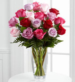 FTD® proudly presents the Captivating Color™ Rose Bouquet by Vera Wang. Bursting with brilliant hues to capture their attention, these beautiful roses in the colors of fuchsia, red, pale pink, light lavender and purple are brought together with fresh, lush greens and perfectly arranged in a modern clear glass vase to create a wonderful way to convey your warmest wishes. Made in our Toronto/North York flower shop by your local florist.