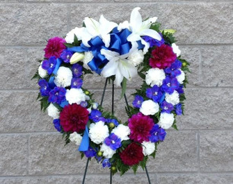 Express your love and sympathy with this lovely mix of blue, white and magenta flowers in a fresh flower heart. We deliver to all funeral homes, chapels and cemeteries in Toronto, North York, Markham, Vaughan and the GTA. Flowers made fresh daily by our skilled florists.