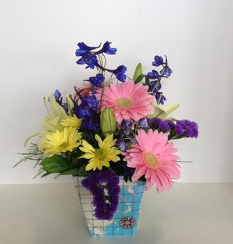 """ You put me on the map "". Thank you teachers for all your help and dedication. Here is a lovely bright flower arrangement in a ceramic container with a map motif. Let our North York and Toronto flower shop and florists make one for you today."