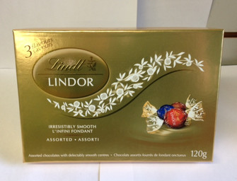 Three flavours of famous Lindt Lindor truffles in a gold box. 120 grams of soft delectable chocolate goodness.