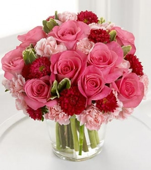 Oh My Love Bouquet Her heart will skip a beat when this florist designed arrangement is hand delivered to her door. Pink roses, Pink carnations and red roses or asters. Great for your anniversay or business anniversary.