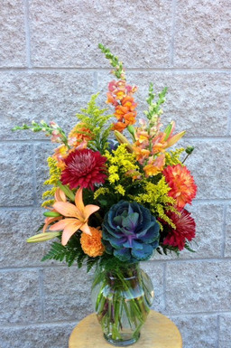 Fall vase with solidago and kale, asiatic lilies, fluffy bronze chrysanthemums, dahlias, mixed foliage and snapdragons. Send this lovely burst of Fall vase. For Rosh Hashanah, a birthday or just because you love Fall. Florist fresh from our Toronto and North York flower shop.