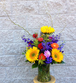 Wow somebody with this dramatic arrangement of sunflowers, delphinium, gerbera, dahlias and curly willow. Made fresh in our Toronto- North York flower shop by our talented designers. We cover all of Toronto and area daily.