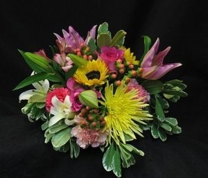A garden of fresh, spring eco flowers. Show her your love today and always. Lilies, Anastasia mums, carnations and roses. Delivery to your home or office. The freshest flowers on hand.