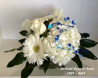 "White roses, hydrangea and gerbera with blue stars. We can deliver in the Toronto, Don Mills, North York, Vaughan and Markham areas as all of the "" GTA ."""