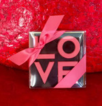After Robert Indiana's iconic painting. Square 90 gram chocolate LOVE square. We deliver Valentine roses to all of Toronto, North York, Vaughan, Markham, Maple, Mississauga and area.