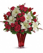 Perfectly romantic! Steal their heart this Valentine's Day or any day with this majestic mix of classic red roses, tulips and white lilies, hand-delivered with love in our exclusive blown glass vase. With its graceful twist and rich red hue, it's an unforgettable symbol of your love.